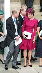 Kate Middleton chose a long-sleeve fuchsia cocktail dress by Alexander McQueen for Princess Eugenie's wedding.