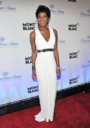 Natalie Cole wore a Grecian white evening gown with a bejeweled waistband for the Princess Grace Awards.