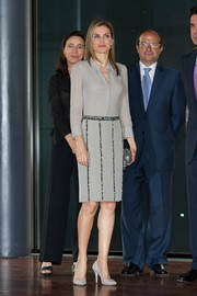 Princess Letizia dressed up her blouse with a bejeweled gray pencil skirt.