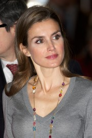Princess Letizia was fresh-faced at the Volunteer State Congress wearing her hair tucked behind her ears.