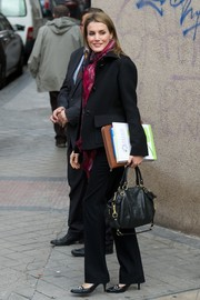 Princess Letizia stopped by the Rare Diseases Spanish Federation carrying a biker-chic leather tote by Coach.