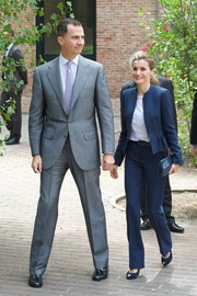 Princess Letizia visited a traditional Students Residence wearing a chic blue pantsuit with peplum detailing.