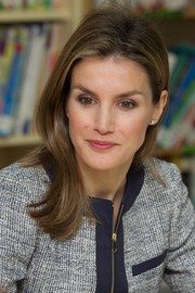 Princess Letizia visited Maria Moliner School wearing her hair in a subtle flip.