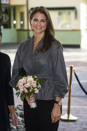 Princess Madeleine accessorized with a classic leather-band quartz watch at the 'Invisibility Project' seminar.