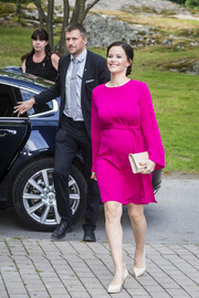 Princess Sofia of Sweden tied her look together with a nude leather clutch.