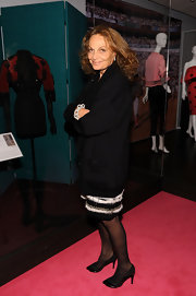 Diane Von Furstenberg donned black leather pumps with patent details. She paired the heels with a black wool coat and of course, her signature voluminous mane.