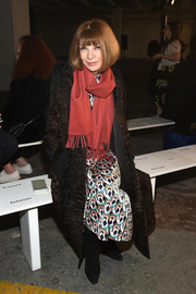 Anna Wintour donned a textured brown coat with fur trim for the Proenza Schouler fashion show.