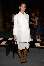 Miroslava Duma went for classic chic in a white pea coat during the Proenza Schouler fashion show.