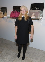Drew Barrymore was fall-chic in her black tights and LBD.