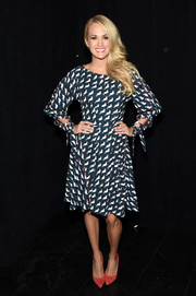 Carrie Underwood donned a print dress in a girly fit-and flare silhouette for the 'Project Runway' fashion show.
