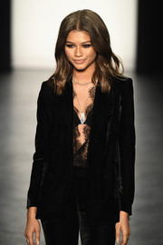 Zendaya Coleman styled her black suit with a silver pendant for the 'Project Runway' fashion show.
