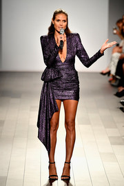 Heidi Klum put on a leggy display in a purple jacquard mini dress by Redemption at the 'Project Runway' fashion show.