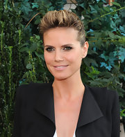 Heidi looked radiant in her sleek bun. She added volume by giving her bangs height.