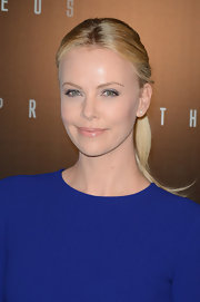 Charlize Theron attended the 'Prometheus' premiere wearing her long blond tresses in a sleek ponytail.