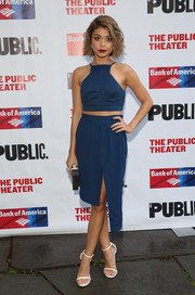 Sarah Hyland completed her ultra-modern look with an asymmetrical blue skirt.