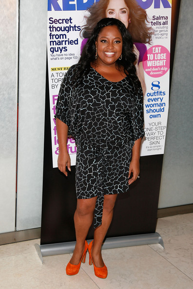Sherri Shepherd added a pop of color to her ensemble with bright orange suede platform pumps.