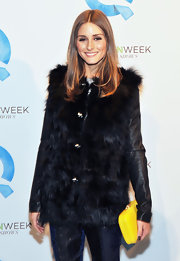 Olivia Palermo kicked up her dark fashion week style with a canary yellow box clutch.