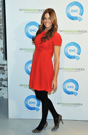 Kelly Bensimon added a pop of drama to his red frock with animal print Mary Jane pumps.