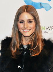 Olivia Palermo wore her shiny hair sleek and straight at the QVC runway show during New York Fashion Week.