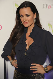 Kyle Richards accessorized with a pair of golden hoop earrings.