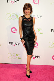 Lisa Rinna looked edgy-elegant at the FFANY Shoes on Sale event in a black lace-panel leather dress.