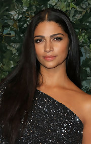 Camila Alves wore her ebony tresses center-parted and sleek at the QVC Red Carpet Style party.