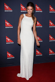 Jennifer looks regal in this floor length white beaded gown. The simple cut show off her perfect figure.
