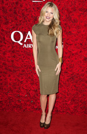 AnnaLynne McCord was chic in a figure-hugging olive midi dress at the Qatar Airways Los Angeles Gala.