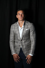 Sonny Bill Williams looked oh-so-suave in his fitted gray plaid jacket.