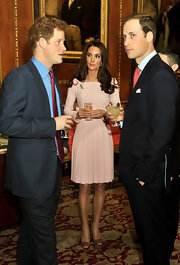 Kate Middleton attended a luncheon wearing copper satin pumps.