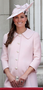 The Duchess of Cambridge wore a soft pink custom wool coat for her last public appearance before giving birth to her first child.