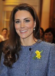 Kate Middleton visited Fortnum & Mason in London wearing a sheer wash of pearly pink lipstick.