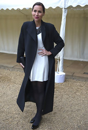 Minnie Driver stuck to a classy and sophisticated look when she chose this sleek ankle-length wool coat.