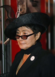 Yoko Ono wore an intricately sculpted black hat as she met the Queen in Liverpool.