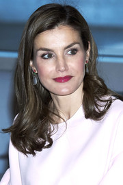 Queen Letizia of Spain topped off her ensemble with a pair of dangling ruby, emerald, and moonstone earrings by TOUS.