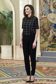 Queen Letizia paired her top with basic black slacks.