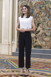 Queen Letizia of Spain was casual-chic in a sleeveless white top and cropped black trousers while attending audiences at Zarzuela Palace.