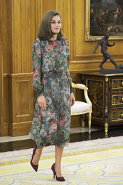 Queen Letizia of Spain looked darling in a Zara floral midi dress with a smocked waist while attending audiences at Zarzuela Palace.