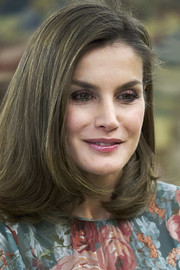 Queen Letizia of Spain's amethyst eyeshadow complemented the flower print on her dress.