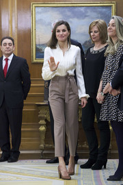 Queen Letizia of Spain kept it classic in a white silk button-down while attending audiences at Zarzuela Palace.