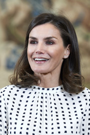 Queen Letizia of Spain wore her hair down to her shoulders with curly ends while attending audiences at Zarzuela Palace.