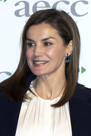 Queen Letizia of Spain stuck to her signature long bob when she attended a cancer forum in Madrid.