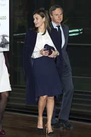 Queen Letizia of Spain topped off her outfit with a black leather clutch.