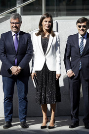 Queen Letizia of Spain attended the 'Inclusion of Disability in News Media' forum wearing a crisp white blazer by Carolina Herrera.
