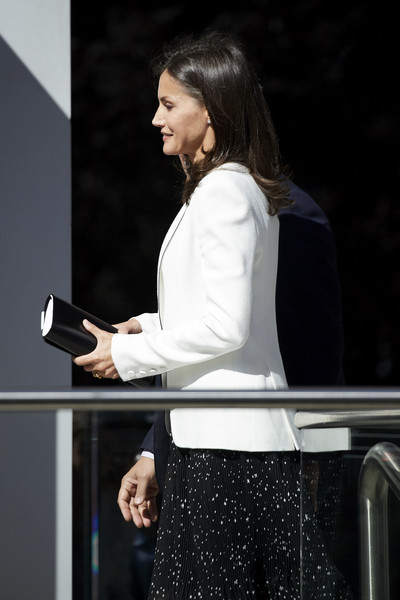 Queen Letizia of Spain headed to the 'Inclusion of Disability in News Media' forum carrying a black-and-white leather clutch by Magrit.