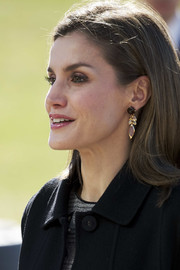 Queen Letizia of Spain accessorized with a lovely pair of dangling gemstone earrings by Coolook for an International Congress.