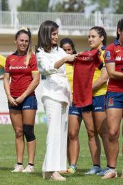 Queen Letizia of Spain was casual-chic in a white linen pantsuit by Carolina Herrera at the training of the Rugby 7 female national team.