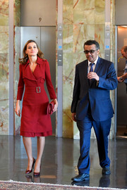 Queen Letizia of Spain looked sharp in a red Burberry trenchcoat while attending a meeting at the WHO headquarters in Geneva.