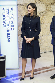 Queen Letizia of Spain was casual-chic in a belted denim shirtdress by Hugo Boss while visiting the International School of Music.