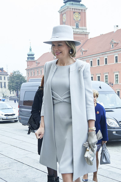 Queen Mathilde of Belgium Printed Clutch [white,street fashion,clothing,photograph,fashion,coat,trench coat,snapshot,outerwear,street,mathilde of belgium,queen,royal,child development,part,poland,warsaw,house of literature,conference,visit]